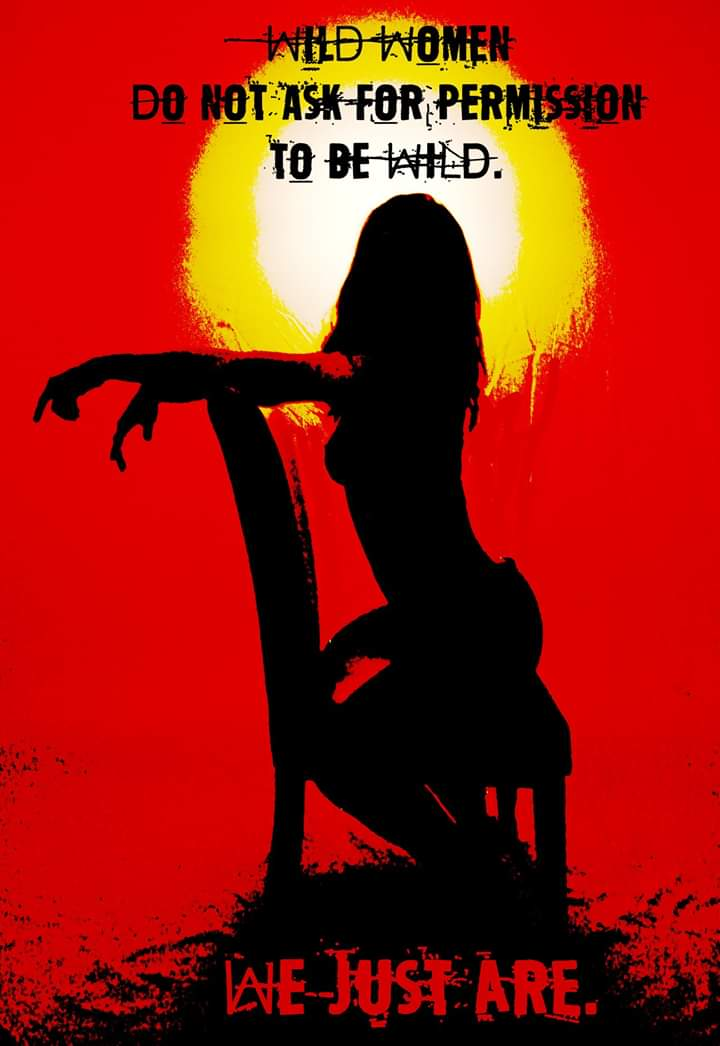 Fiery sunset background with silhouette of sexy wild woman sitting backwards in a chair with her back arched and her face turned upwards.